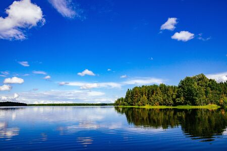 Lake landscape at summer in rural Finland 写真素材
