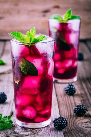 Blackberry mojito  cocktail  with lime,  mint and ice