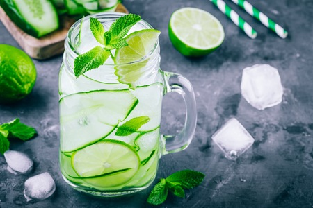 infused: Ice cold and refreshing detox water cucumber and mint in a glass jar