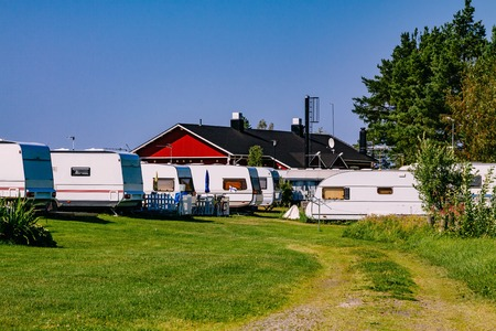 Camping life with caravans in nature park in rural Finland