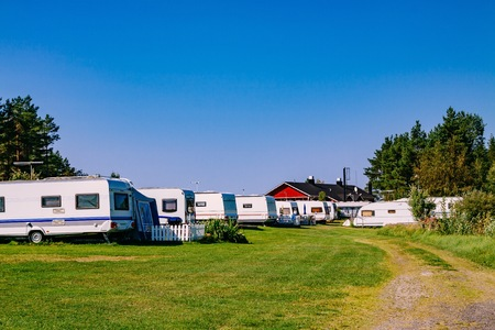 Camping life with caravans in nature park in rural Finland Stock Photo - 84623360