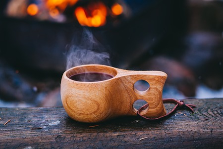Mulled wine served from finnish wooden cup, kuksa Stock Photo - 90752050