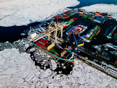 Industrial port with containers in winter, vessel loading in port of Finland Stock Photo