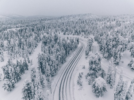 Aerial view of forest covered with snow in Finland, Lapland. Beautiful winter landscape. Stock Photo