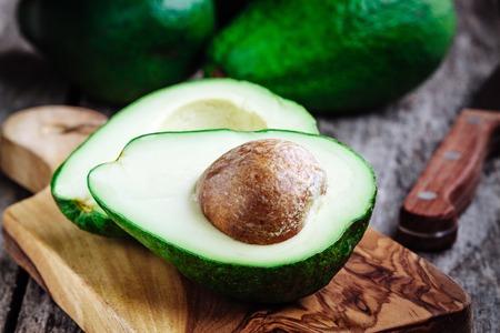 Fresh raw organic avocado on a rustic wooden background Zdjęcie Seryjne