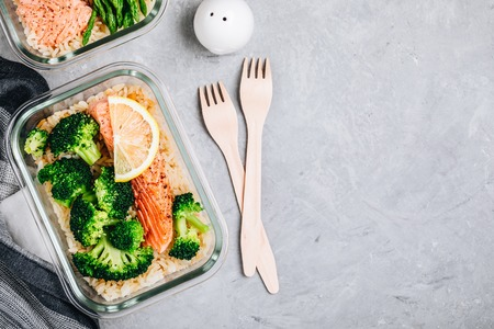 Meal prep lunch box containers with grilled salmon fish, rice, green broccoli Standard-Bild