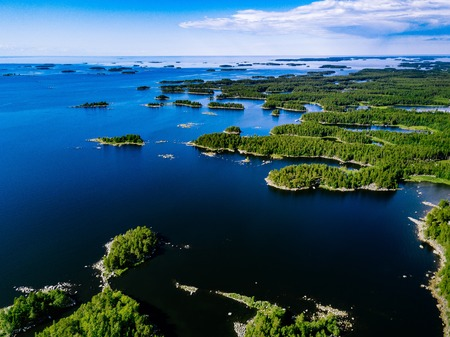 Aerial view of blue lakes and green forests on a sunny summer day in rural Finland. Drone photography from above 스톡 콘텐츠