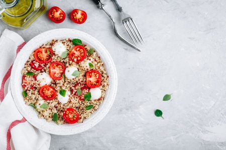 Healthy Bowl Lunch Salad with Quinoa, Mozzarella Cheese, Tomatoes and Basil Reklamní fotografie