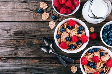 Whole Grain healthy cereals with fresh blueberries and raspberries for breakfast. Top view