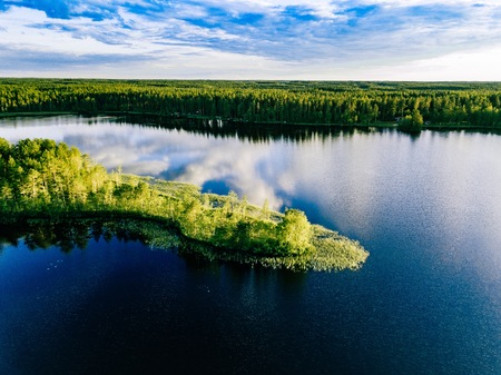 Aerial view of blue lakes landscape with green forests on a sunny summer day in Finland. Drone photography from above Фото со стока