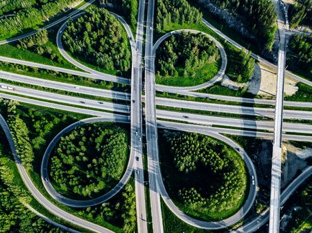Aerial top view of Highway road and overpass with green forests on a summer day in Finland. Stock fotó - 133847619