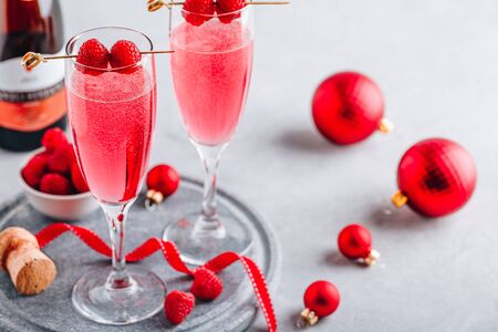 Pink Raspberry Mimosa Cocktail with champagne or prosecco for New Year