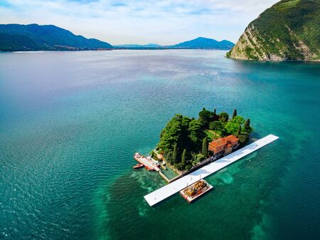 The island of San Paolo (Isola di San Paolo) in Iseo lake in Italy. Beautiful summer landscape with alps and blue lake water.