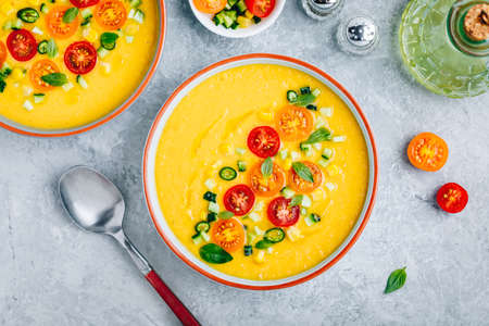 Yellow Tomato Gazpacho. Spanish summer cold soup with fresh vegetables.