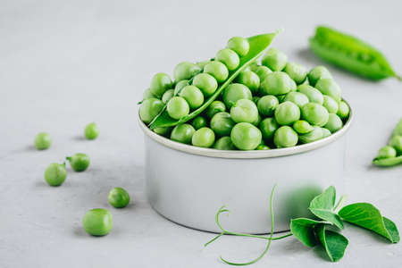 Organic Fresh Raw Green Peas in a Bowl