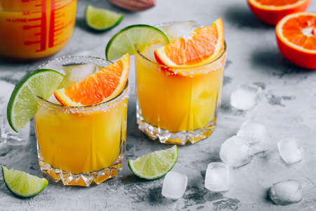 Orange Lime Margarita. Refreshing summer drink with ice in glass