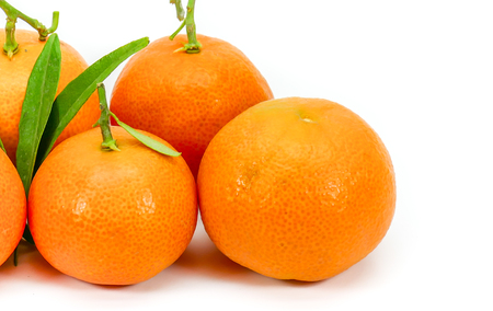 clementines: Miniature Corsican clementines isolated on white