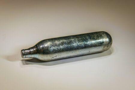 Aluminium gas Co2 cartridge for air gun isolated vintage sepia style.