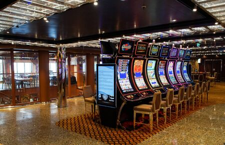 Barcelona, Spain, July 11, 2016 : Casino interior room with slot machines on a cruise boat. Gambling entertainment concept