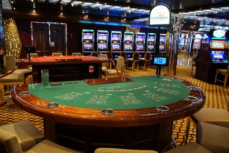Barcelona, Spain, July 11, 2016 : Casino interior room with blackjack Table and slot machines on a cruise boat. Gambling entertainment concept. Stock Photo