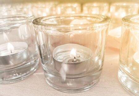 Candles in small little glasses during the vigil ceremony and prayer.