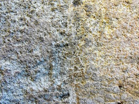 Texture of old and damaged stone wall with colored stains for design, background or wallpaper. 版權商用圖片