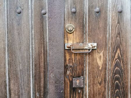 Very old door with hardware, handle and lock