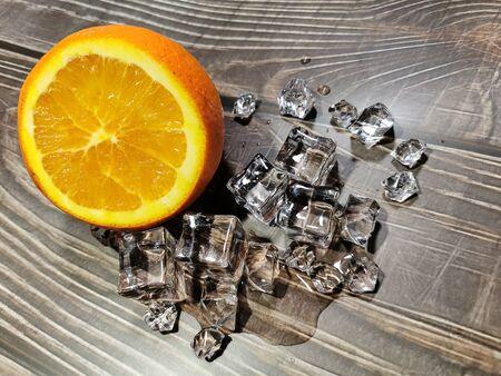 A very fresh cut orange with ice cubes Фото со стока