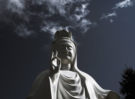 Spectacular cloud over the statue of GuanYin, the Goddess of Mercy and Compassion in the buddhist religion, manifestation of the divine Mother and serves humanity and mankind, much the same way as Mother Mary