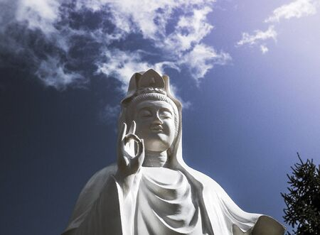 Spectacular cloud over the statue of GuanYin, the Goddess of Mercy and Compassion in the buddhist religion, manifestation of the divine Mother and serves humanity and mankind, much the same way as Mother Mary Foto de archivo