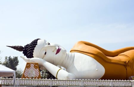 reclining: Reclining Buddha with sky in Nakhornsrithammarat province, south of Thailand