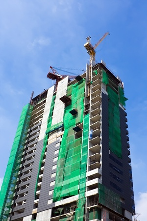 Building under construction with blue sky