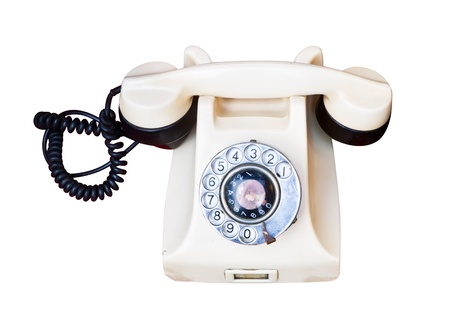 Old telephone with rotary dial isolated on white