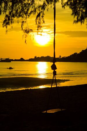 Sunset with swing at Koh Chang island,Thailand photo