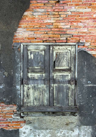 Old window and old wall with old brick photo