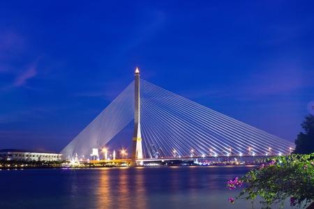 The Rama 8 Bridge at twilight time in Bangkok, Thailand
