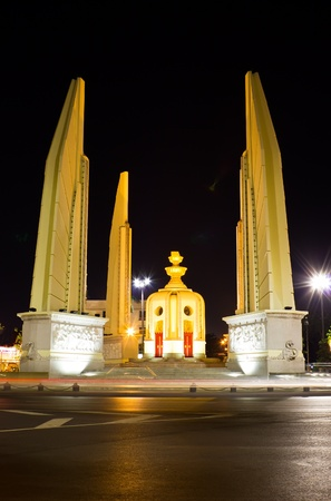 Democracy monument at night in Bangkok, Thailand photo