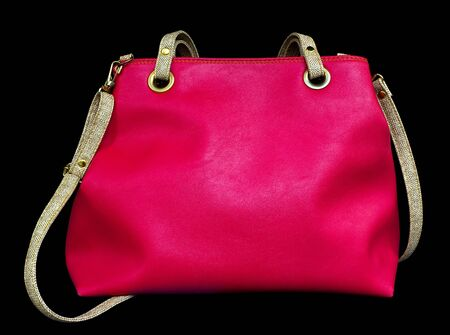 Pink bag isolated on black background