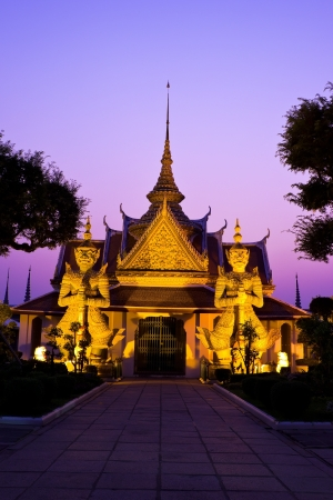 Giant  in Arun temple, Bankok Thailand at twilight time