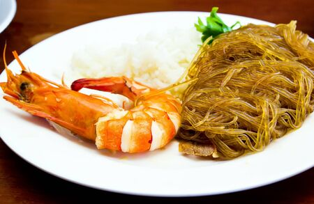 Prawn and cellophane noodle fried in plate Stock Photo