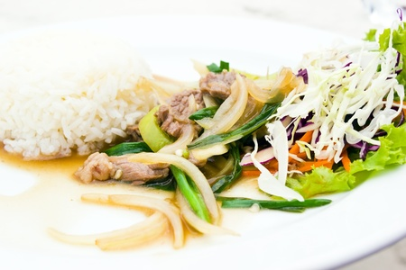 Steamed rice with fried sweet pepper with meat in plate