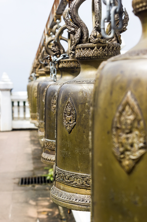 Row of Buddhism bell in temple to ring to be good luck