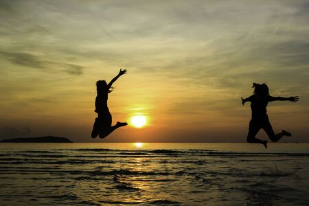 sunrise beach: Happy friend jump enjoy sunrise on the beach Stock Photo