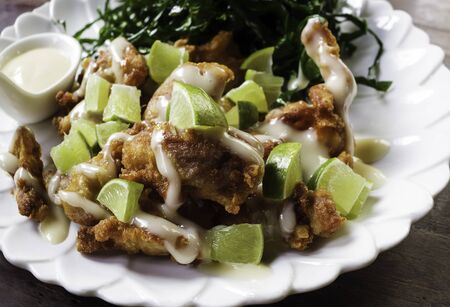 Fried chicken with lemond cuisine Stock Photo