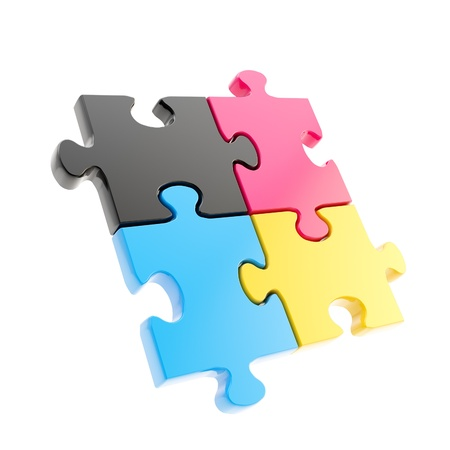 Linked puzzle four cmyk colored jigsaw pieces isolated on white photo