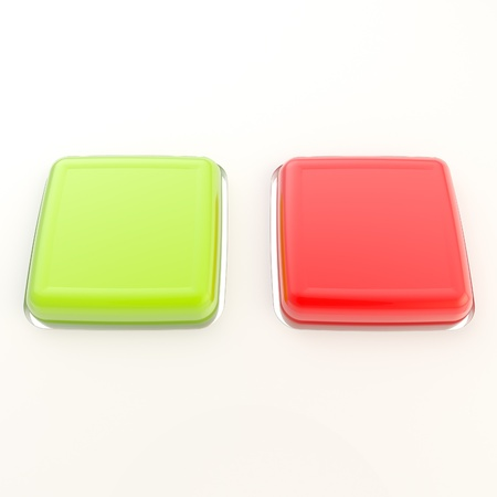 Two copyspace red and green glossy buttons over white plastic surface photo