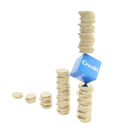 credit risk: Credit risk conception image  golden coin piles with one on the verge of cube isolated on white background