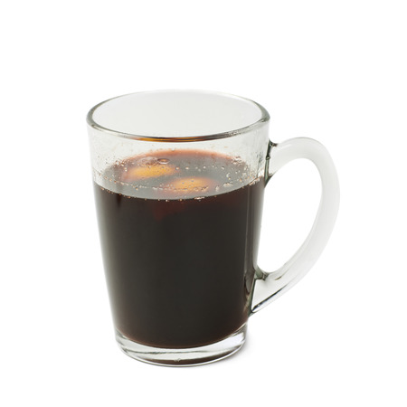 punch spice: Glass mug filled with mulled wine and orange peels, composition isolated over the white background