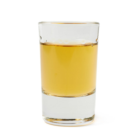 shot: Glass shot of whiskey bourbon isolated over the white background