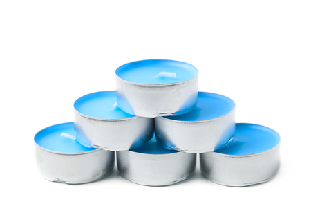 blue candles: Pyramid of tealight paraffin wax blue candles isolated over the white background
